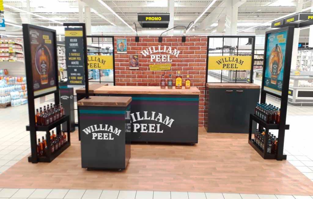 Montage et conception stand shop in shop en supermarché