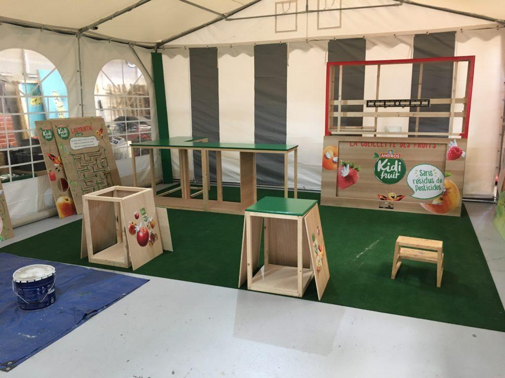 Atelier de fabrication et logistique stand centre commercial